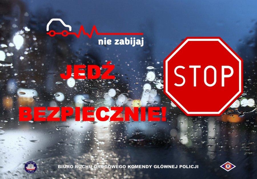 grafika z napisem nie zabijaj — jedź bezpiecznie w tle mokra szyba, po prawej stronie znak drogowy STOP